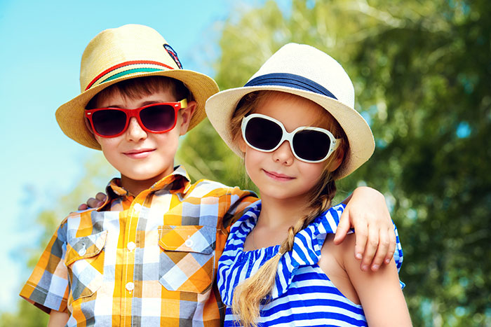 young boy and girl wearing sunglasses