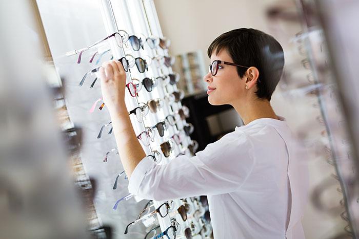 woman looking at eyewear selection